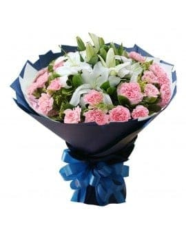 21 Pink Carnations with 6 Lilies